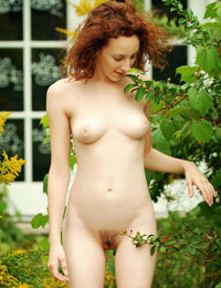 Taneka is in the mood for teasing in the garden